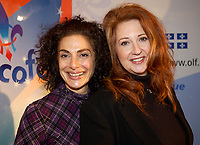 March 12th, 2002, Montreal, Quebec, Canada<br /> <br /> Singers Sylva  Balassanian (L) and Laurence Jalbert (R) Pose for photographers after the press conference for the upcoming Franco FÍte, in Quebec City.<br /> March 12th 2002, in Montreal, Canada