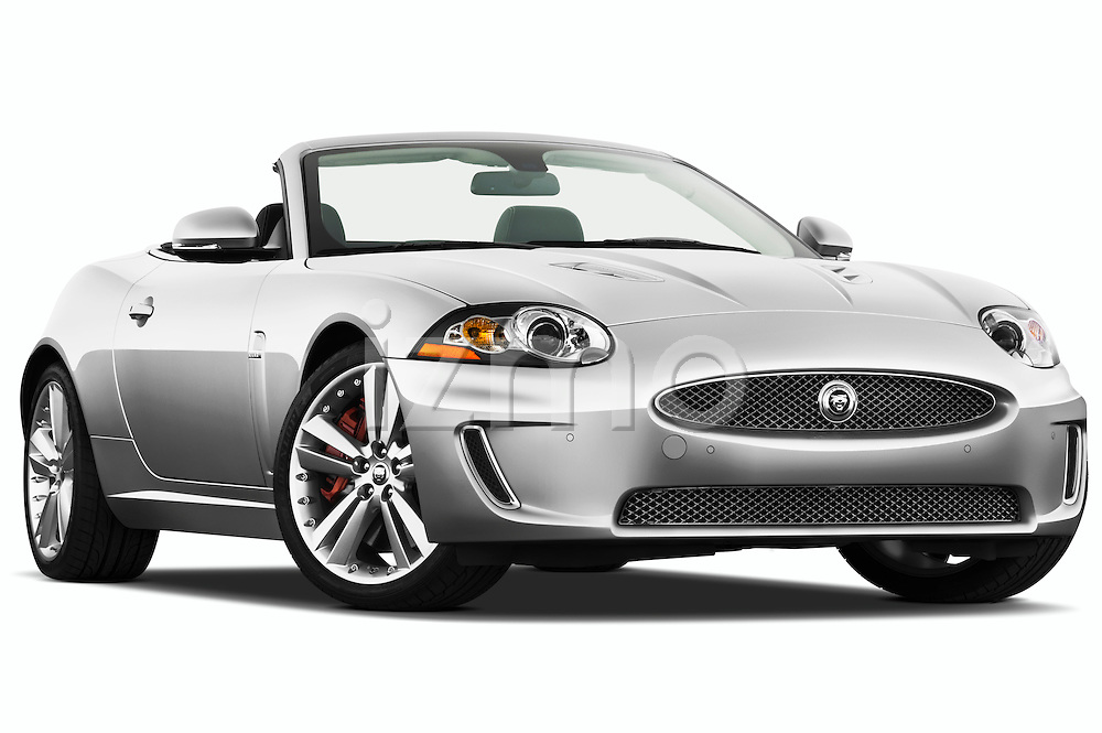 Low aggressive passenger side front three quarter view of a 2011 Jaguar XKR Convertible.