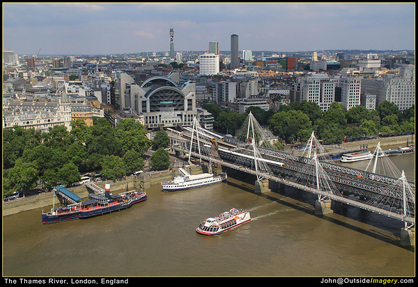 England, London. View of the Thames River from the London Eye. <br /> When the sky is uninteresting, you don't need a lot of it. Here the sky functions more as an overhead frame, so the viewer knows where the top of the horizon is. Stunning cloudscape might warrant more sky.  I was a little lucky in that both a tour boat and train passed by.