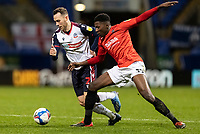 Bolton Wanderers' Gethin Jones competing with Salford City's Di'Shon Bernard (right) <br /> <br /> Photographer Andrew Kearns/CameraSport<br /> <br /> The EFL Sky Bet League Two - Bolton Wanderers v Salford City - Friday 13th November 2020 - University of Bolton Stadium - Bolton<br /> <br /> World Copyright © 2020 CameraSport. All rights reserved. 43 Linden Ave. Countesthorpe. Leicester. England. LE8 5PG - Tel: +44 (0) 116 277 4147 - admin@camerasport.com - www.camerasport.com