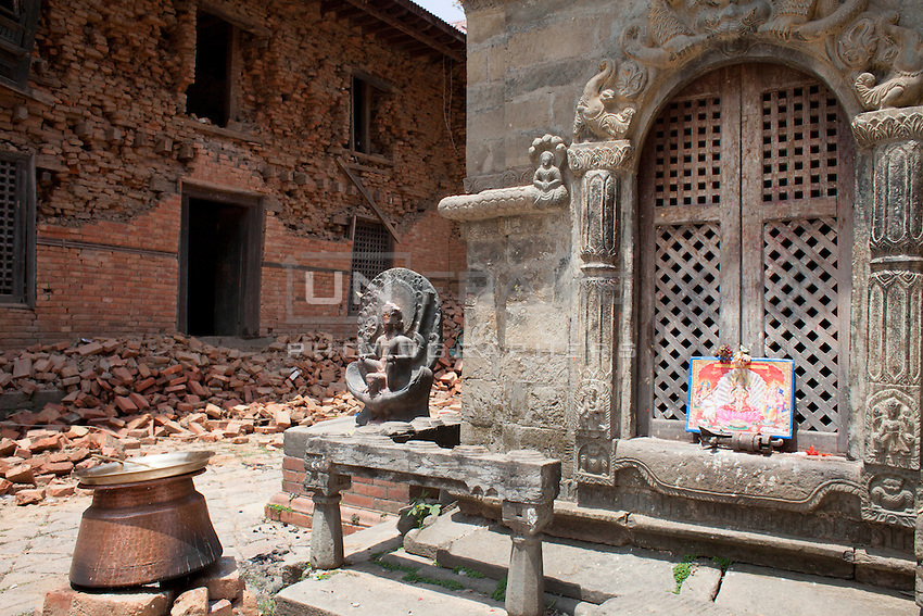 Two of the four temples on the premises of Changu Narayan square in Bhaktapur have been reduced to rubble by the earthquake that hit the Nepal on last month. The main temple of Changu Narayan is on the verge of collapse.<br /> Believed to have been built in the fifth century, the two-tiered pagoda is considered to be one of the most unique architectural monuments in the country. Bhaktapur, Nepal. May 05, 2015