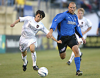 12 June 2004: Earthquakes Craig Waibel fights with the ball against MetroStars Joselito Vaca at Spartan Stadium in San Jose, California.    Earthquakes defeated MetroStars, 3-1.  Mandatory Credit: Michael Pimentel / ISI