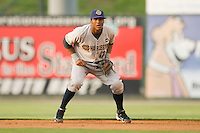 Second baseman Jimmy Paredes #13 of the Charleston RiverDogs on defense against the Kannapolis Intimidators at Fieldcrest Cannon Stadium May 29, 2010, in Kannapolis, North Carolina.  Photo by Brian Westerholt / Four Seam Images