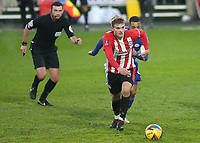 Marcus Forss of Brentford in possession, as referee, Michael Oliver looks on during Brentford vs Leicester City, Emirates FA Cup Football at the Brentford Community Stadium on 24th January 2021