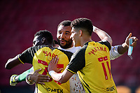 24th April 2021; Vicarage Road, Watford, Hertfordshire, England; English Football League Championship Football, Watford versus Millwall; Troy Deeney celebrates with Ismaïla Sarr and Adam Masina.