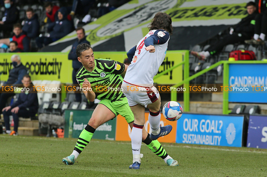 Bolton Wanderers's MJ Williams and Forest Green Rovers's Kane Wilson during Forest Green Rovers vs Bolton Wanderers, Sky Bet EFL League 2 Football at The New Lawn on 27th March 2021