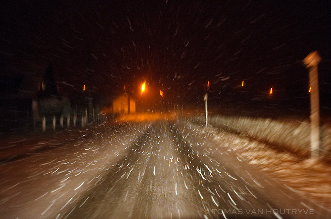 Snow falls on a rural road near Lessines, Belgium on March 23, 2013.