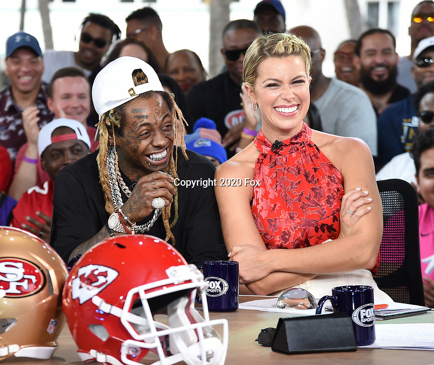 """MIAMI BEACH, FL - JANUARY 31: Lil Wayne joins Jenny Taft on the set of """"Skip & Shannon: Undisputed"""" on the Fox Sports South Beach studio during Super Bowl LIV week on January 31, 2020 in Miami Beach, Florida. (Photo by Frank Micelotta/Fox Sports/PictureGroup)"""