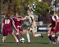 Boston College forward Kristen Mewis (19) attempts to dribble past Florida State midfielder Amanda DaCosta (13). Florida State University defeated Boston College, 1-0, at Newton Soccer Field, Newton, MA on October 31, 2010.