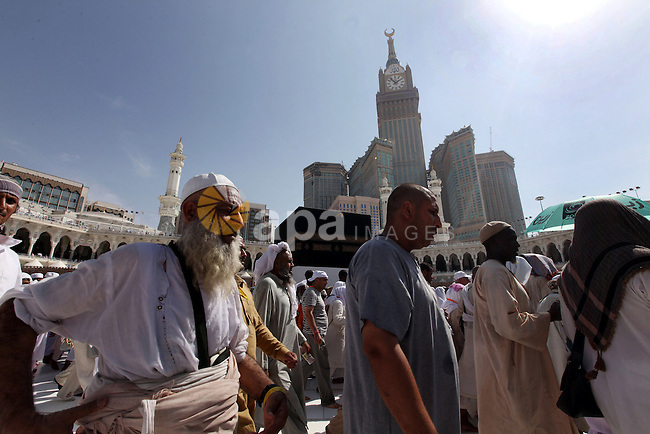 Muslim pilgrims walk around the Kaaba in the Grand Mosque of the holy city of Mecca on October 21, 2012. Over two million Muslims from around the world are expected to perform the upcoming Hajj or pilgrimage. Photo by Moemen Faiz