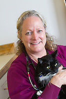 Veterinarian Tracy Fuelleman, DVM, holds Milton, a 14-year-old male black cat at the Eastlake Veterinary Hospital in Seattle, Washington.