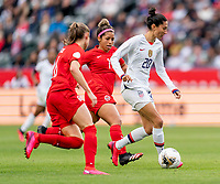 CARSON, CA - FEBRUARY 9: Christen Press #20 of the United States dribbles during a game between Canada and USWNT at Dignity Health Sports Park on February 9, 2020 in Carson, California.