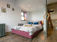 BNPS.co.uk (01202 558833)<br /> Pic: BNPS<br /> <br /> A resourceful couple have made a £150,000 profit after knocking down a derelict old farm building and constructing an impressive eco-friendly retreat in its place.<br /> <br /> Art technician Danielle Coates, 33, and her husband Ben, 33, a carpenter, have created The Rookery, in the scenic village of Roughlee, East Lancs.<br /> <br /> They spent £200,000 buying six acres of farmland and building the two bedroom detached stone home. It has been a shrewd investment as the property, which was completed in 2015, is now valued at £350,000.<br /> <br /> They are currently renting out the two bedroom cottage as a holiday let on cottages.com, with it generating an annual turnover of £50,000.<br /> <br /> Original stones from the demolished farm building have been incorporated into the new structure. Solar panels have been fitted to generate enough energy to run the entire house, and recycled timber from the farm used to fashion shelves and handles.