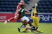 Washington Freedom forward Abby Wambach (20) takes a shot on goal as Chicago Red Stars defender Ifeoma Dieke (4) and goalkeeper Caroline Jonsson (1) defend.  The Washington Freedom defeated the Chicago Red Stars 3-2 at Toyota Park in Bridgeview, IL on July 26, 2009.