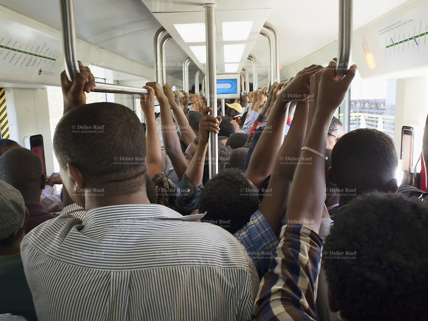 Ethiopia. Addis Ababa. Passengers and handrails on tramway. Addis Ababa Light Rail is a light rail transportation system in Addis Ababa. A 17-kilometre line running from the city centre to industrial areas in the south of the city opened on 20 September 2015. Service began on 9 November 2015 for the second line (west-east). The total length of both lines is 32 kilometres with 32 stations. Trains are expected to be able to reach maximum speeds of 70 km/h. The railway was contracted by the China Railway Group Limited and is nowdays operated by the Shenzhen Metro Group. The Ethiopian Railways Corporation began construction of the double track electrified light rail transit project in December 2011 after securing funds from the Export-Import Bank of China. This light-rail system was the first to be built in sub-saharan Africa. Addis Ababa is the capital city and the name of a region of Ethiopia. 20.11.15 © 2015 Didier Ruef