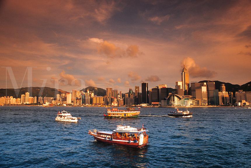 Boats and famous skyline of Hong Kong Island from the Kowloon side looking at Hong Kong at sunse