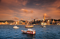 Boats and famous skyline of Hong Kong Island from the Kowloon side looking at Hong Kong at sunse