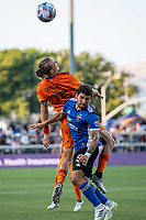 SAN JOSE, CA - JULY 24: Griffin Dorsey #25 of the Houston Dynamo heads the ball alongside Eric Remedi #5 of the San Jose Earthquakes during a game between San Jose Earthquakes and Houston Dynamo at PayPal Park on July 24, 2021 in San Jose, California.