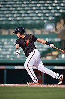 GCL Orioles catcher Jose Montanez (31) follows through on a swing during the first game of a doubleheader against the GCL Twins on August 1, 2018 at CenturyLink Sports Complex Fields in Fort Myers, Florida.  GCL Twins defeated GCL Orioles 7-6 in the completion of a suspended game originally started on July 31st, 2018.  (Mike Janes/Four Seam Images)