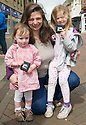 The Litter Strategy team £80 Litter Fine Information Day.... Amanda Coe and her daughters Charlotte (right) and Eilidh receive a spot prize for using a High Street Litter Bin to dispose of their litter.