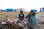 ARBAT, IRAQ: Syrian children warm themselves by the fire in the Arbat refugee camp...45 families who have fled the violence in Syria are currently living in the Arbat refugee camp 19km outside the Iraqi city of Sulaimaniyah...Photo by Zmnako Ismael/Metrography