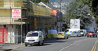Pictured: A police cordon outside the house where the body of Alison Jane Farr-Davies was discovered in Swanse, Wales, UK Wednesday 14 September 2016<br /> Re: A man has been arrested on suspicion of murder following the death of a woman in the Hafod area of Swansea.<br /> The body of 42 year old Alison Jane Farr-Davies was found dead at a home in Neath Road, at about 13:35 on Tuesday.<br /> Police said officers responded to several calls from residents who reported seeing a man in the road between 13:00 and 14:00, and appealed for witnesses to come forward.<br /> The arrested man, 37, remains in custody at Swansea Central station.<br /> Acting Det Supt Kath Pritchard thanked people who stopped at the scene to help on Tuesday.