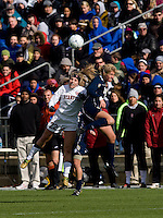 Allison McCann (22) of Stanford fights goes up for a header against Lauren Fowlkes (9)  of Notre Dame during the final of the NCAA Women's College Cup at WakeMed Soccer Park in Cary, NC.  Notre Dame defeated Stanford, 1-0.