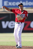 Gabriel Noriega #5 of the High Desert Mavericks makes a throw against the Lake Elsinore Storm at Mavericks Stadium in Adelanto,California on June 12, 2011. Photo by Larry Goren/Four Seam Images