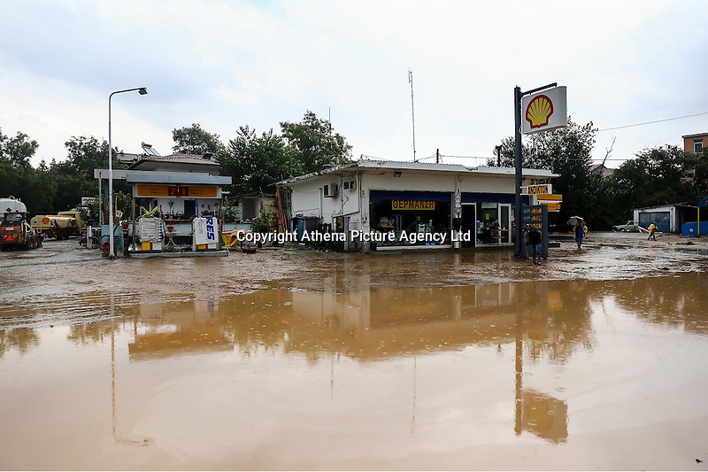 A Shell garage surrounded by a flooded road in Nea Mihaniona