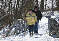 Sue Boll (from left) and Mark boll of Bella Vista hike, Thursday, February 18, 2021 at Tanyard Creek in Bella Vista. Check out nwaonline.com/210219Daily/ for today's photo gallery. <br /> (NWA Democrat-Gazette/Charlie Kaijo)
