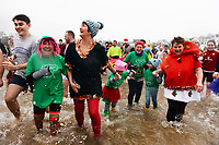 Hundreds of people in fancy dress have taken part in this year's new year's day swim in Saundersfoot, Wales, UK. Wednesday 01 January 2010