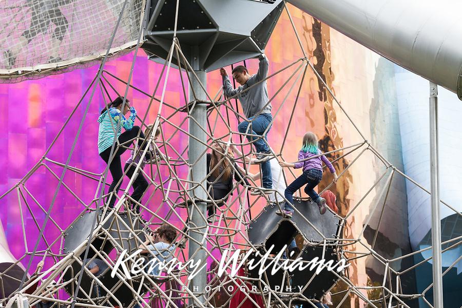Children climbing and playing on rope playground, Northwest Folklife Festival 2016, Seattle Center, Washington, USA.