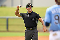 Umpire Denver Dangerfield throws in the first professional hit ball from FCL Pirates Black Henry Davis (not shown) during a game against the FCL Rays on August 3, 2021 at Charlotte Sports Park in Port Charlotte, Florida.  Davis was making his professional debut after being selected first overall in the MLB Draft out of Louisville by the Pittsburgh Pirates.  (Mike Janes/Four Seam Images)