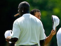 Tiger Woods and Michael Jordan shake hands after a practice round during the 2007 Wachovia Championships at Quail Hollow Country Club in Charlotte, NC.