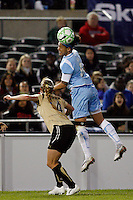 Natasha Kai (6) of Sky Blue FC heads the ball over Rachel Buehler (4) of FC Gold Pride. Sky Blue FC and FC Gold Pride played to a 1-1 tie during a Women's Professional Soccer match at TD Bank Ballpark in Bridgewater, NJ, on April 11, 2009.