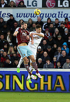 Pictured L-R: Andy Carroll of West Ham against Federico Fernandez of Swansea Saturday 10 January 2015<br /> Re: Barclays Premier League, Swansea City FC v West Ham United at the Liberty Stadium, south Wales, UK