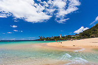 Swimmers, sunbathers and others enjoy Waimea Bay Beach Park on the North Shore of O'ahu.