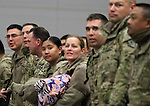 Members of the 422nd Expeditionary Signal Battalion of the Nevada National Guard look for family in the crowd after returning home Sunday, Jan. 15, 2012, after a yearlong deployment to Afghanistan. Hundreds of family and friends greeted the soldiers at the Nevada Air Guard Base in Reno, Nev..Photo by Cathleen Allison