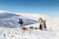 Pictured: A young family strolls at Storey Arms in the Brecon Beacons, Wales, UK. Monday 11 December 2017<br /> Re: Freezing temperatures, snow and ice has affected parts of the UK.