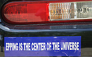 Epping is the center of the universe bumper sticker on car in the White Mountains of New Hampshire USA