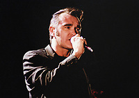 03 June 2020 - Morrissey showed his solidarity for Black Lives Matter on Twitter with the hashtag #TheShowMustBePaused to support the music community's Blackout Tuesday. While some of Morrissey's fans praised his showing of solidarity, others criticized the tweet because of his often controversial political views in the past.  File Photo: Morrissey performs on stage in 2000 at Hamilton Place Theatre, Hamilton, Ontario, Canada. Photo Credit: Brent Perniac/AdMedia