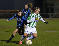 20131213 - VARSENARE , BELGIUM : Zwolle's Tessa Klein Braskamp (right) pictured with Brugge's Lore Dezeure in her back during the female soccer match between Club Brugge Vrouwen and PEC Zwolle Ladies , of  matchday 14  in the BENELEAGUE competition. Friday 13th December 2013. PHOTO DAVID CATRY