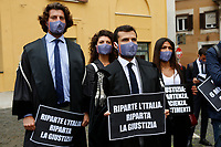 Young lawyers showing banners during the demonstration AIGA, Association of Young Lawyers, in Montecitorio Square, to ask the Government a quick restart of justice activities after the stop due to the Coronavirus pandemic. The banner says Italy restart, justice must restart. Rome (Italy) June 11th 2020<br />  <br /> <br /> Photo Samantha Zucchi Insidefoto