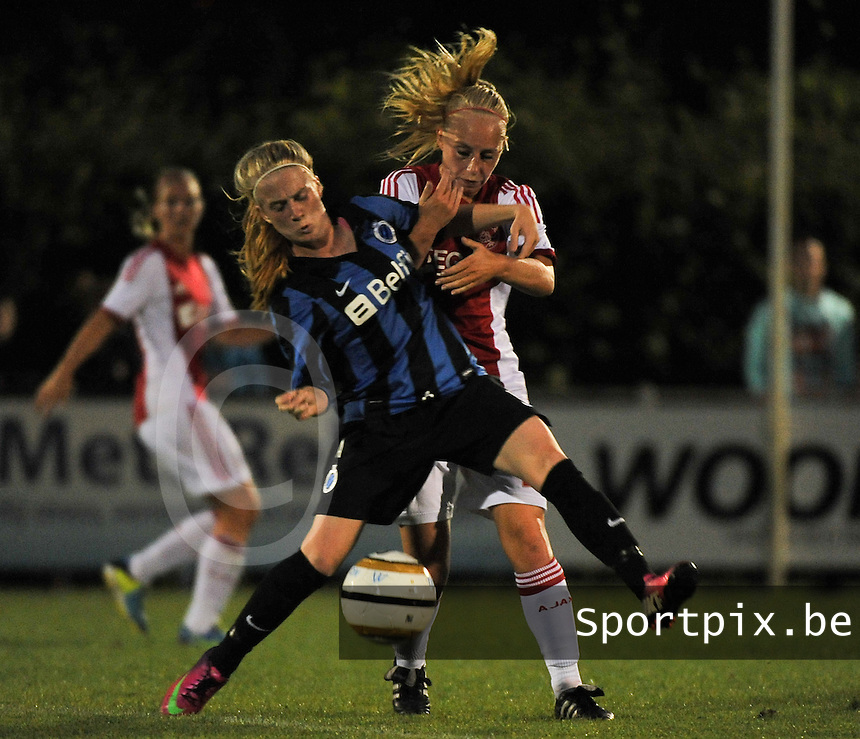 20130830 - VARSENARE , BELGIUM : Brugge's Silke Demeyere pictured in a duel with Ajax' Inessa Kaagman (behind) during the female soccer match between Club Brugge Vrouwen and Ajax Amsterdam Dames , of the first matchday in the BENELEAGUE competition. Friday 30 August 2013. PHOTO DAVID CATRY