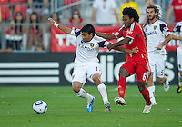 28 August 2010: Real Salt Lake midfielder Javier Morales #11 and Toronto FC midfielder Julian de Guzman #6 in action during a game between Real Salt Lake and Toronto FC at BMO Field in Toronto..The game ended in a 0-0 draw..