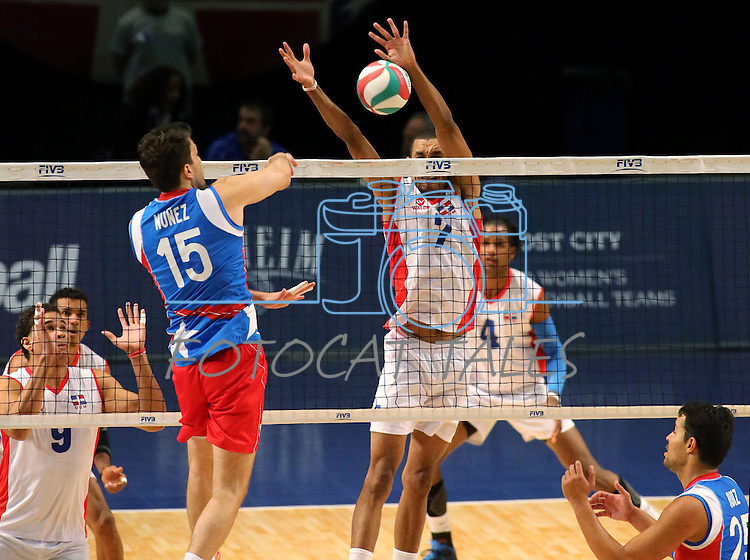 Josue Nunez with Puerto Rico hits at Dominican Republic blocker Tavares Frias during the Pan American Cup at the Reno Events Center in Reno, Nev., on Monday, Aug. 17, 2015. <br /> Photo by Cathleen Allison