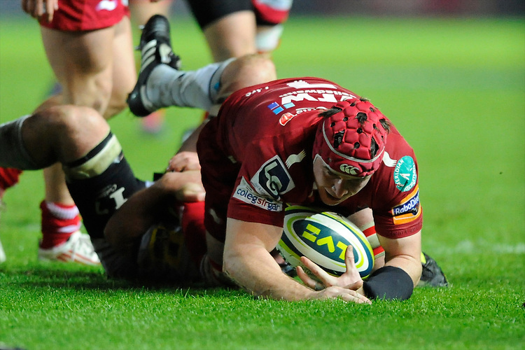 Johnathan Edwards of Scarlets is brought down during the LV= Cup first round match between Scarlets and Leicester Tigers at Parc y Scarlets (Photo by Rob Munro, Fotosports International)