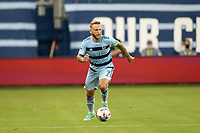 KANSAS CITY, KS - JULY 31: Johnny Russell #7 Sporting KC with the ball during a game between FC Dallas and Sporting Kansas City at Children's Mercy Park on July 31, 2021 in Kansas City, Kansas.