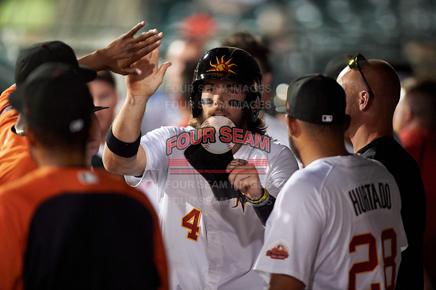 Mesa Solar Sox Brandon Marsh (4), of the Los Angeles Angels organization, is congratulated by teammates after scoring a run during an Arizona Fall League game against the Scottsdale Scorpions on September 18, 2019 at Sloan Park in Mesa, Arizona. Scottsdale defeated Mesa 5-4. (Zachary Lucy/Four Seam Images)