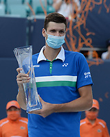 MIAMI GARDENS, FL - APRIL 04: Hubert Hurkacz poses with the championship trophy after defeating Jannik Sinner 7-6 (7-4) 6-4 during the Men's finals at the 2021Miami Open at Hard Rock Stadium on April 4, 2021 in Miami Gardens, Florida. <br /> CAP/MPI04<br /> ©MPI04/Capital Pictures